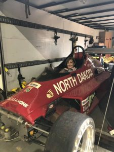 Patti Donney sits in the Skip Barber Saab